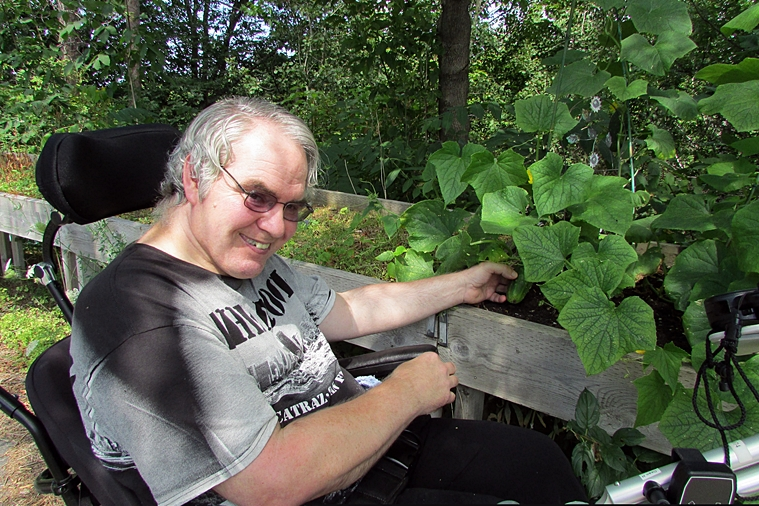 Dean enjoying his crops at Forest Hill Garden